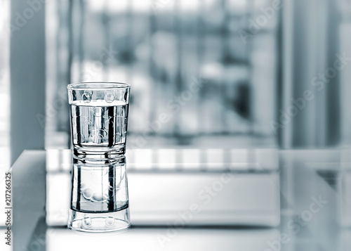 Close Up Purified Fresh Drink Water With Reflection On Glass Table