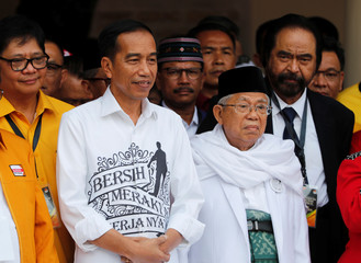 Indonesian President Joko Widodo and his running mate for the 2019 presidential elections Islamic cleric Ma'ruf Amin meet supporters in Jakarta