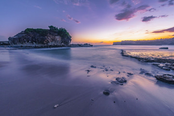 Beautiful beach in sunset evening, long exposure shot. Klayar beach, Pacitan, East Java, Indonesia