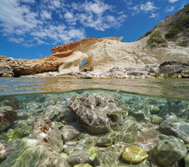 Rock formation on the seashore with fish and rocks underwater, split view above and below water surface, Mediterranean sea, Cala Blanca, Javea, Costa Blanca, Alicante, Valencia, Spain