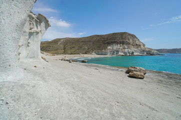 Sandstone cliff and beach in Cala de Enmedio, Agua Amarga, Cabo de Gata-Nijar Natural Park, Mediterranean sea, Almeria, Andalusia, Spain