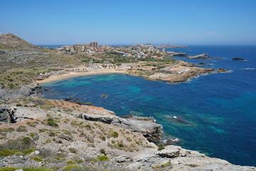 Spain coastal landscape, rocky coast with sandy beach in the seaside town Cabo de Palos, Cartagena, Murcia, Mediterranean sea