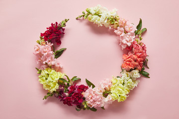 close-up view of tender wreath of beautiful fresh flowers on pink