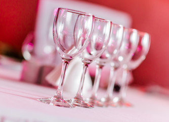 Empty wine glasses in a row on a table