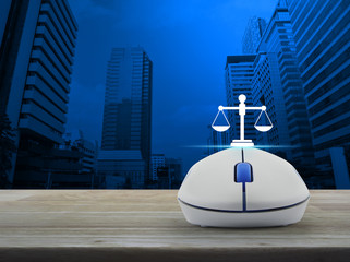 Law flat icon with wireless computer mouse on wooden table over modern office city tower and skyscraper, Business legal service online concept