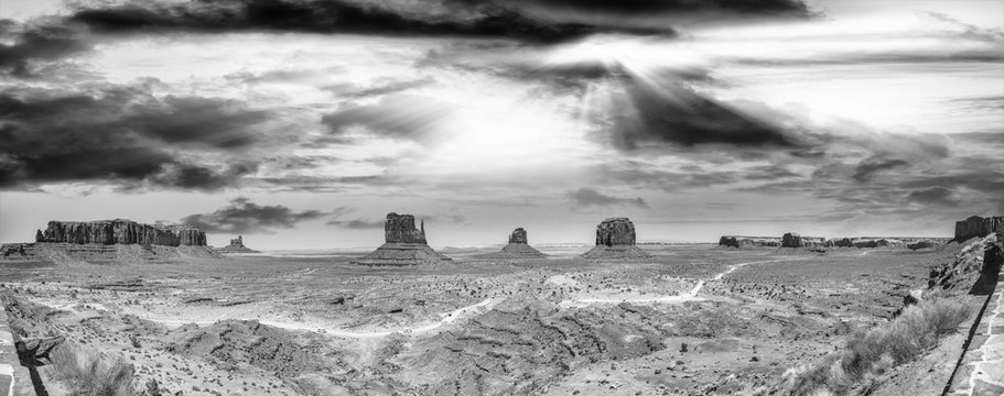 Panoramic aerial view of Monument Valley landscape at sunset, black and white view