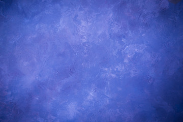 Blue lighted wall texture for designer background. Painted surface.