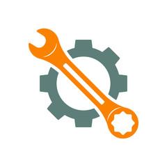 Icono plano engranaje con llave en diagonal en gris y naranja