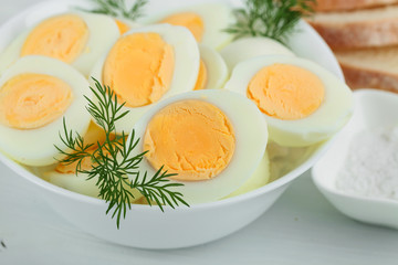 Boiled eggs with dill .