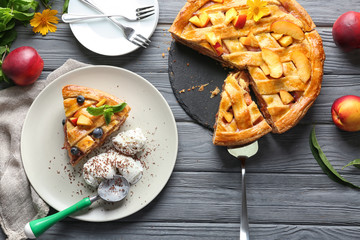 Composition with tasty homemade peach pie on table