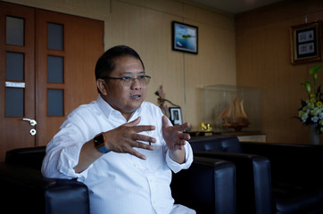 Indonesian Minister of Communication and Information Technology, Rudiantara, gestures during an interview with Reuters at his office in Jakarta