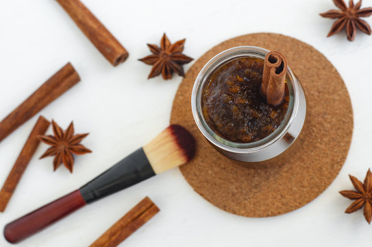 Homemade pumpkin spice facial mask/scrub made with ripe pumpkin puree, sugar and honey, cinnamon powder and ground coffee. DIY cosmetics. Top view, copy space.