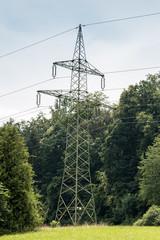Power pylon on the green field