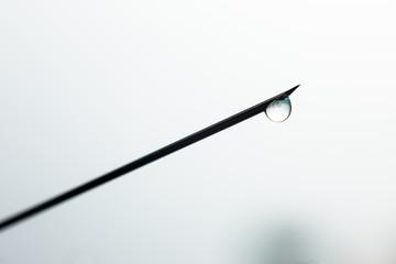 Close up Syringe needle medicine with liquid medicine drop