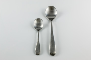 Steel cutlery with table spoon and little spoon