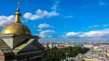Tower of St. Isaac's Cathedral close-up, St. Petersburg, Russia. View of St. Petersburg from a height, cityscape.