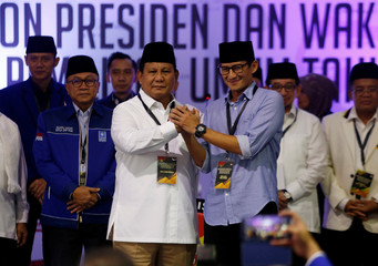 Prabowo Subianto and Sandiaga Uno shake hands after they registered as candidates for the 2019 presidential election in Jakarta