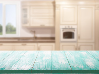 Kitchen, background. Empty textured wooden table and kitchen window shelves blurred background