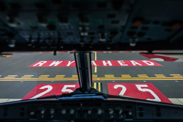 Commercial airliner airplane flight cockpit during takeoff