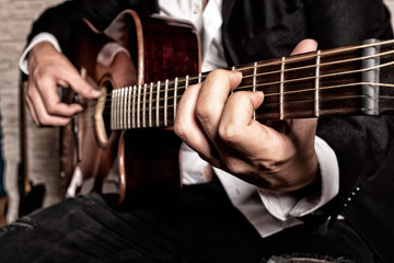 hands of musician playing the guitar
