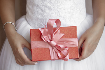 Bride holding her red gift box