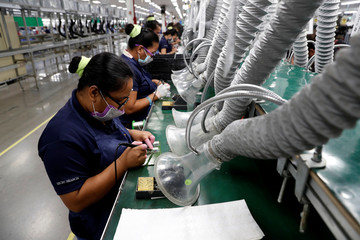 Filipinos work at the assembly line of Kinpo Electronics factory in Malvar