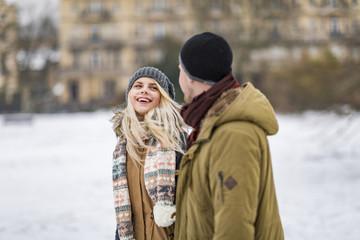 Portrait of happy teenage girl looking at boyfriend