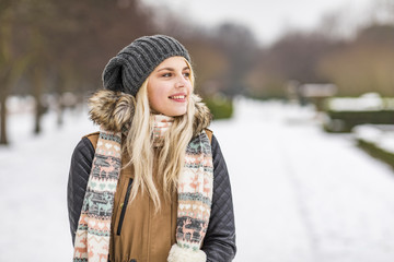 Portrait of smiling teenage girl in winter