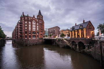 Warehouse district of Hamburg (Speicherstadt) at night. Panorama.