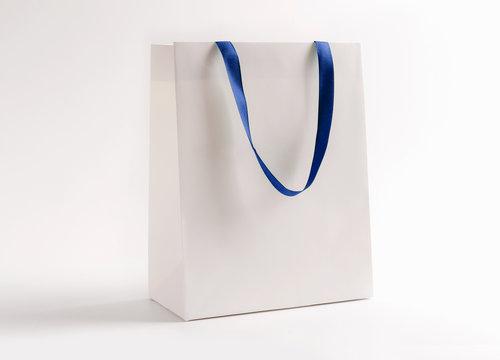 White shopping bag isolated on white background.