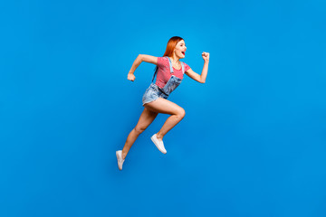 Full-size portrait of running marathon girl who looks in front o