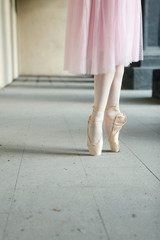 Ballet dancers dancing on street. Young ballerinas in color tutus. Ballet feet on the point