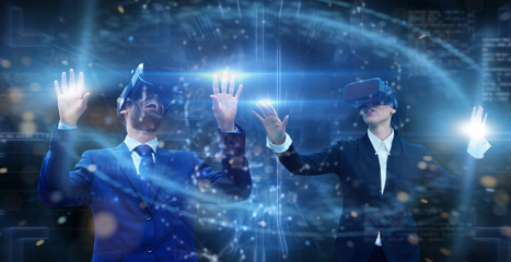 new technologies, two persons uses a futuristic processor for augmented reality. high technology and communication concept. TV