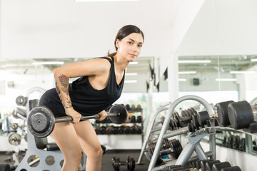 Fototapeta Athlete Doing Bent Over Row Exercise With Barbell In Gym obraz