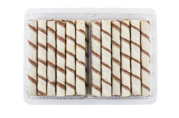 Striped tubes with cream in plastic container isolated on white