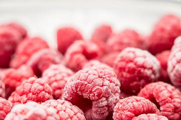 Frozen raspberries close up