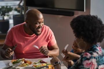 Family having breakfast on dinning table