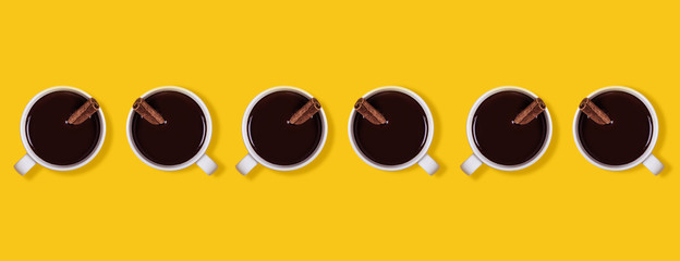 Pattern Hot chocolate cups with cinnamon. Warming winter or autumn drink concept