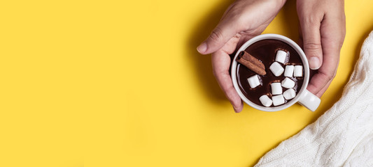 Female hands hold a thick hot chocolate cup