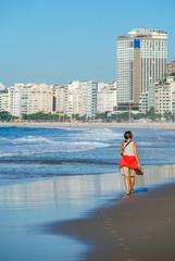 Woman walking on the beach of Copacabana, Rio de JaneiroWomen walking on the beach of Copacabana, Rio de Janeiro