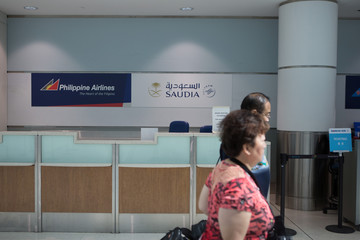 People arrive at Toronto Pearson International Airport from Saudi Airlines flight from Riyadh, in Toronto