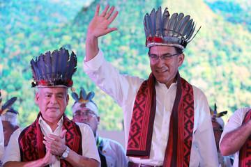 Peru's President Martin Vizcarra (R) accompanied by Prime Minister Cesar Villanueva attend the inauguration of 'Expo Amazonia' in Pucallpa
