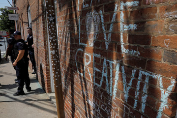 "Police officer patrols at the site where Heather Heyer was killed during the 2017 Charlottesville ""Unite the Right"" protests in Charlottesville"