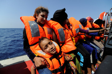 Migrants are rescued by SOS Mediterranee during a search and rescue (SAR) operation in the Mediterranean Sea