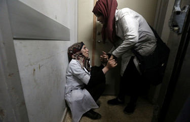 Colleagues of Palestinian medic Abdullah Al-Kotati, who was killed while trying to help wounded protesters at the Israel-Gaza border, react at a hospital in the southern Gaza Strip