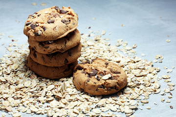 Chocolate cookies on rustic table. Chocolate chip cookies and cookies with oat flakes or oatmeal.