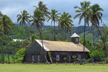 Stone church surrounded by palm trees at Keanae, a traditional Hawaiian village along the Hana Highway, Maui, Hawaii