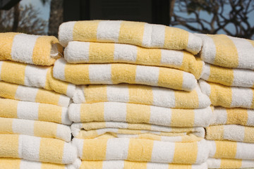 Stack of yellow striped towels
