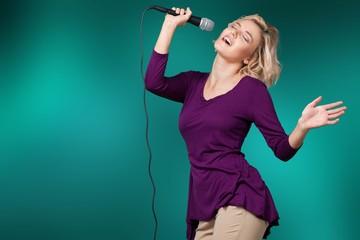 Female Rockstar Singing With Retro Vintage Microphone