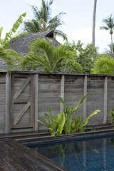 Fenced swimming pool in the tropics